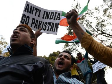 Activists shout slogans against JNU and Afzal Guru outside the university in New Delhi. AFP