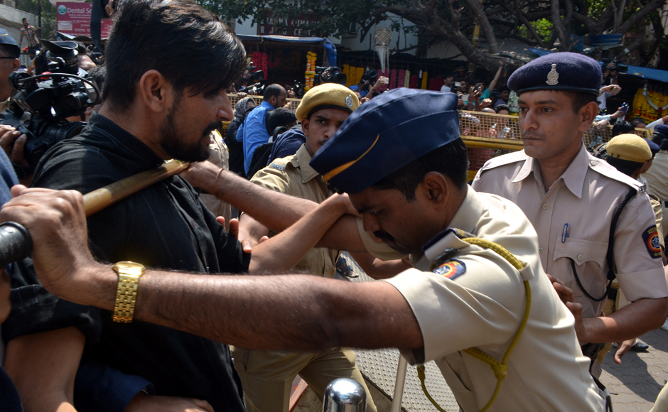 Photojournalists gathered outside the Siddhivinayak temple to get shots of Sanjay Dutt were beaten by Mumbai Police. This image shows one such journalist resisting the lathi charge. Firstpost