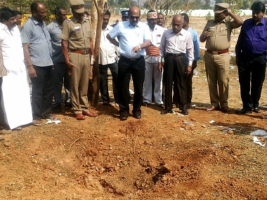 Authorities inspect the site of a suspected meteorite landing in Vellore. AFP