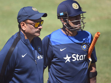 File photo of Ravi Shahstri and MS Dhoni. AFP
