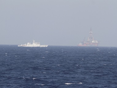 A ship of Chinese Coast Guard is seen near Chinese oil rig Haiyang Shi You 981 in the South China Sea. Reuters