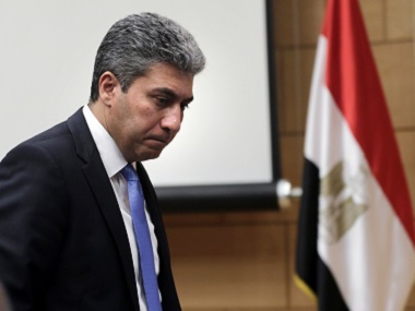 Egyptian Minister of Civil Aviation Sharif Fathy leaves a press conference at the Ministry headquarters in Cairo. AP