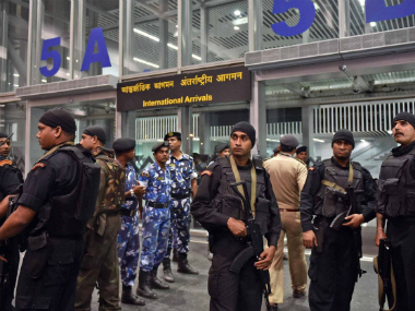 Security personnel present at the Kolkata airport ahead of the arrival of the Pakistan contingent on 12 March. PTI