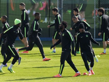 Manchester City players warm up during a team training session at the City Football Academy. AFP