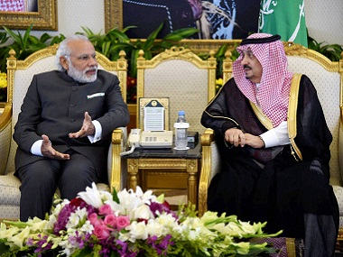 Prime Minister Narendra Modi with Governer of Riyadh Faisal Bin Bandar al Saud at the Riyadh airport on Friday. PTI