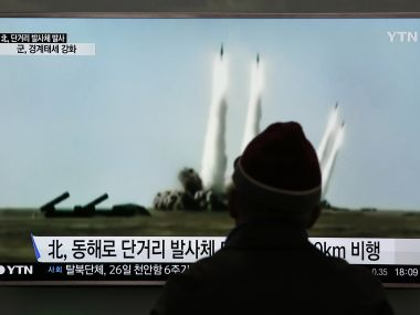 A man watches a TV screen showing a file footage of the missile launch conducted by North Korea, at Seoul Railway Station in  South Korea. AP
