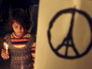 A child pays tribute to the victims of the November 2015 Paris attacks. Reuters