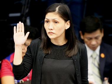 Maia S. Deguito, Rizal Commercial Banking Corporation (RCBC) branch manager, takes her oath prior to the start of the Philippine Senate Blue Ribbon Committee probe. AP