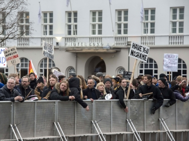 "Demonstrators hold posters reading ""Have you no shame"" during a protest gather outside the parliament in Reykjavik. AFP"