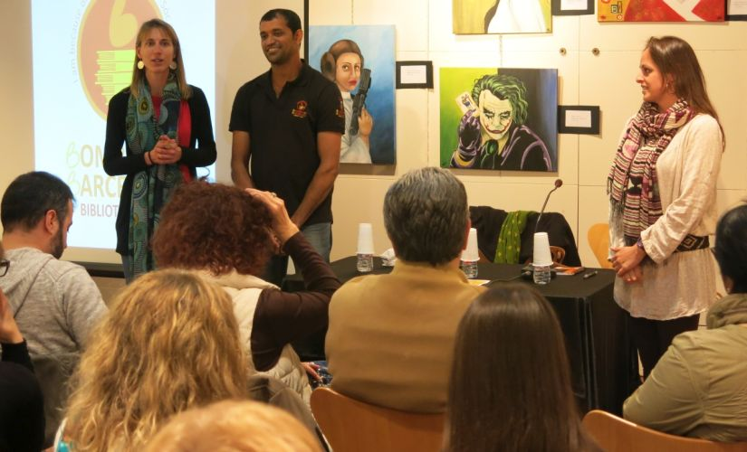 Amin delivering a talk on the Bombay to Barcelona Library Cafe project in Europe.