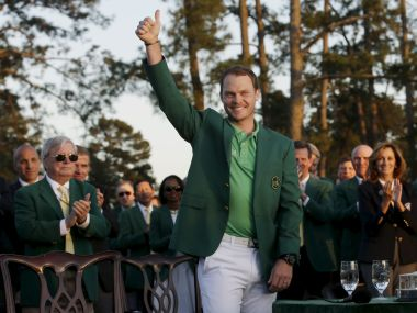 Danny Willett celebrates in the green jacket after winning the 2016 The Masters golf tournament at Augusta National Golf Club. Reuters