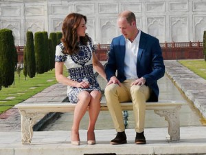 Britain's Prince William, along with his wife, Kate, the Duchess of Cambridge, pose in front of the Taj Mahal in Agra on Saturday. PTI