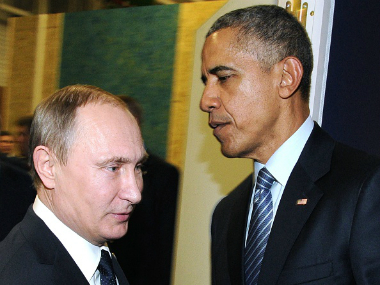 Russian President Vladimir Putin (L) with US President Barack Obama on the sidelines of the UN conference on climate change in November 2015