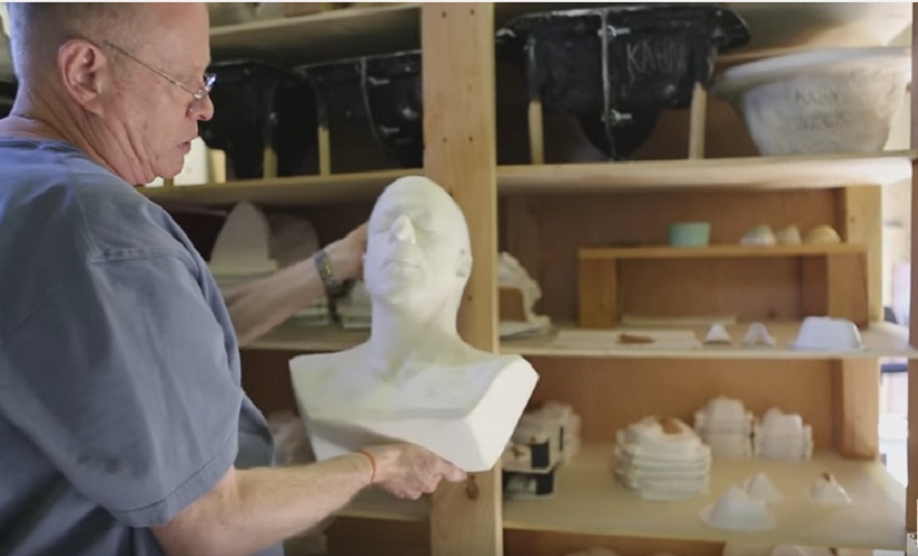 Greg in his studio. Screen grab from YouTube