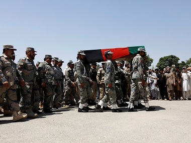 Afghan security forces carry the coffin of an Afghan soldier, who was killed during gun fighting between Afghan border forces and Pakistani forces in Torkham. Reuters