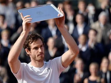Andy Murray holds his trophy after coming in second in the men's final. AFP