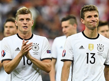 Germany's midfielders Toni Kroos (left) and Thomas Mueller after the goalless draw against Poland. AFP