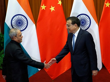 President Pranab Mukherjee meets China's Premier Li Keqiang at the Great Hall of the People in Beijing. File photo Reuters