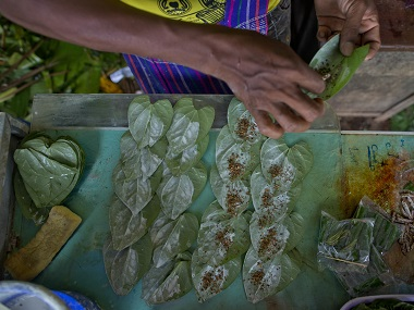 "A retail seller wraps ""Kun-ya"" at a market in Yangon. AP"