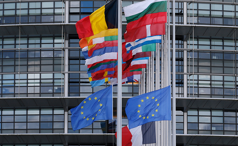 The French and European flags fly at half-mast among flags of the other member states of the European Union in front of the European Parliament in Strasbourg, France, in tribute to the victims of Nice Bastille Day truck attack on 15 July 2016. Reuters