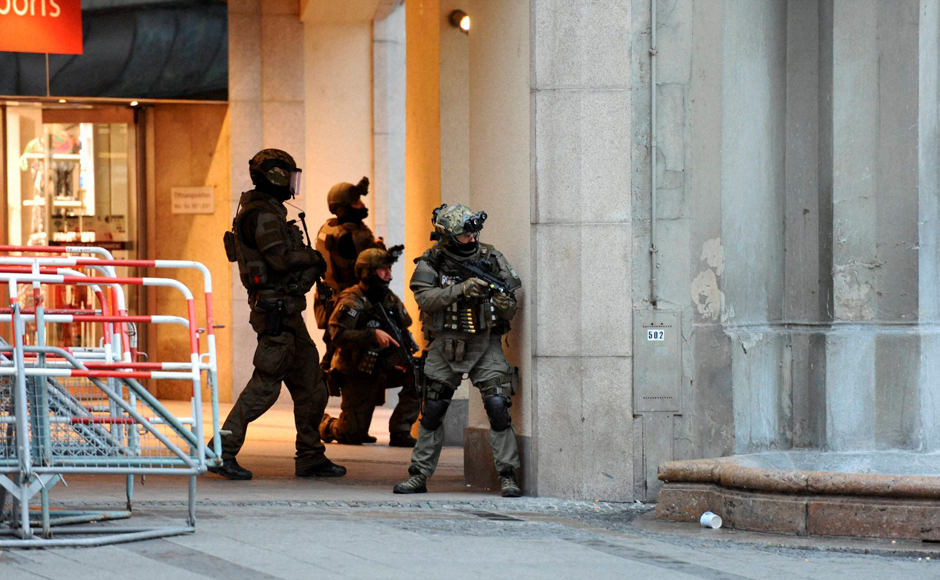 Heavily armed police forces operate at Karlsplatz (Stachus) square after a shooting inthe Olympia shopping centre was reported in Munich. The shooting left atleast 10 people dead, including the shooter. AP