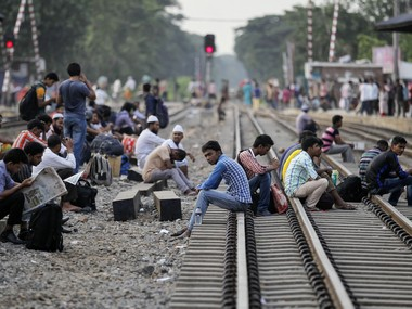 Passengers wait for trains to go home ahead of the Muslim holiday of Eid al-Fitr, at a railway station in Dhaka, Bangladesh, Friday, July 1, 2016. Hundreds of thousands of people working in Dhaka leave for their home towns every year to celebrate Eid al-Fitr with their family. AP