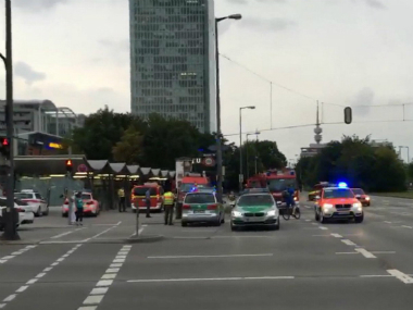 Police responding to a shooting at the Munich shopping centre on Friday. AP