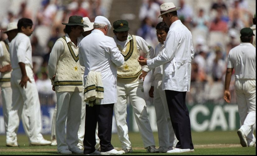 The umpires and the Pakistan team discuss the condition of the ball during the Third Test match against England at Old Trafford in Manchester, England. Getty