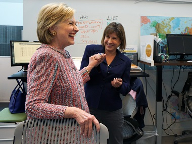 Hillary Clinton laughs with PanXchange CEO Julie Lerner at a campaign stop in Denver. Reuters
