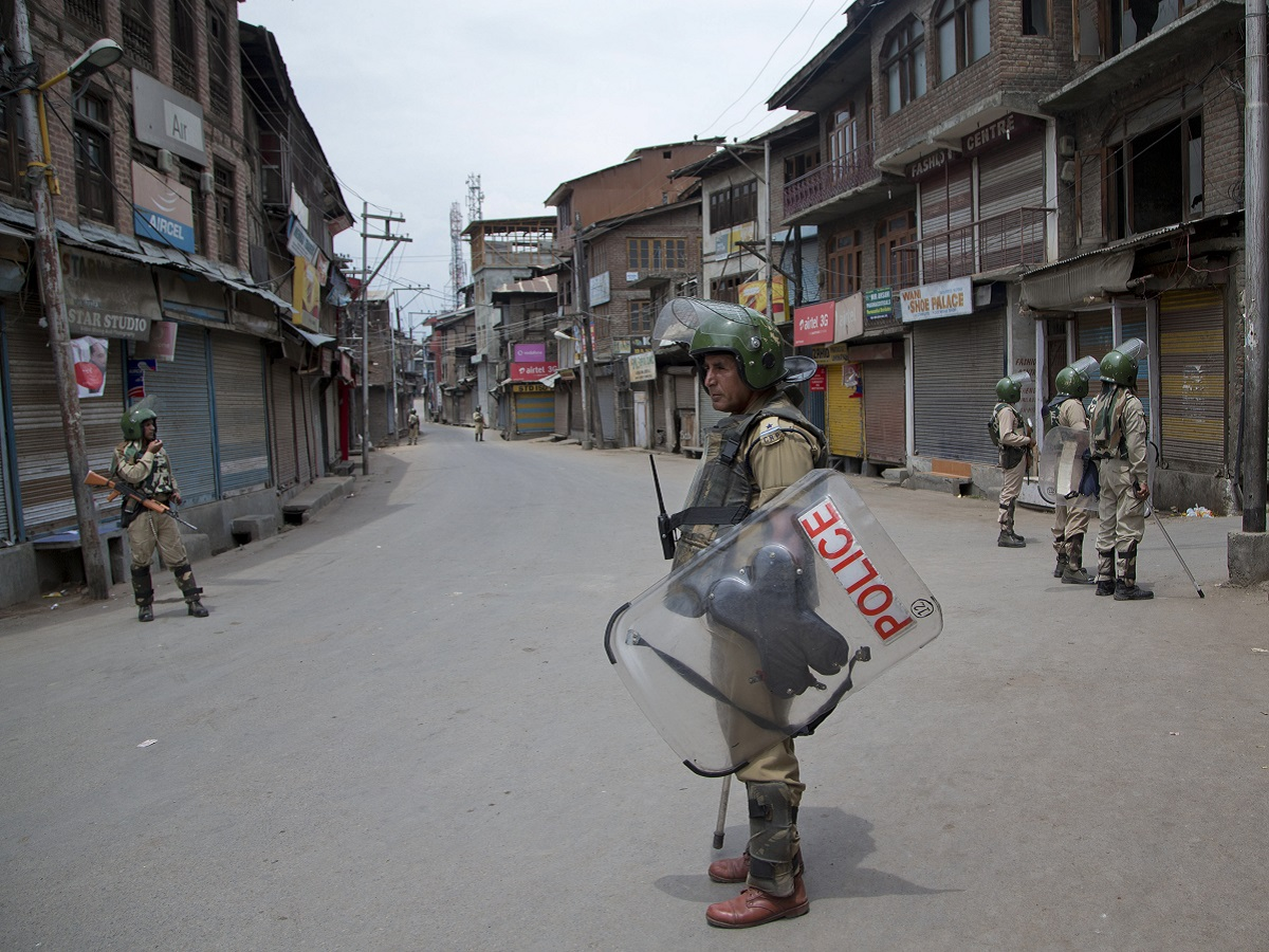 Indian paramilitary soldiers stand guard in Kashmir while curfew is on. AP