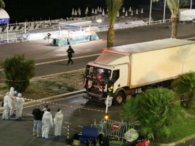 Investigators inspect the trust involved in the Nice attack. AP