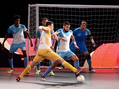 Mumbai 5's and Chennai 5's (yellow) players in action during their match at Premier Futsal Football League, at Nehru Indoor Stadium in Chennai on Friday. PTI