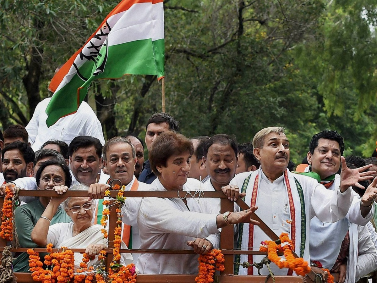 UP Congress President Raj Babbar with party's CM candidate Sheila Dikshit at a roadshow on Sunday. PTI