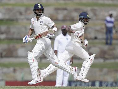 India's captain Virat Kohli, left, and teammate Shikhar Dhawan. AP