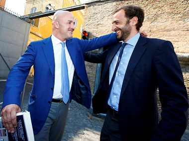 Journalists Emiliano Fittipaldi (R) and Gianluigi Nuzzi smile as they leave the Vatican at the end of their trial. Reuters