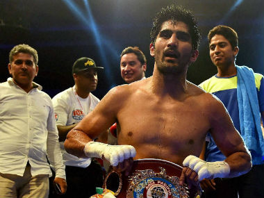 Vijender Singh celebrates after being crowned WBO Asia Pacific champion. PTI