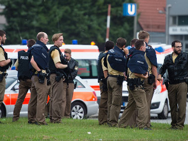 Police officials after the Munic attack. AP