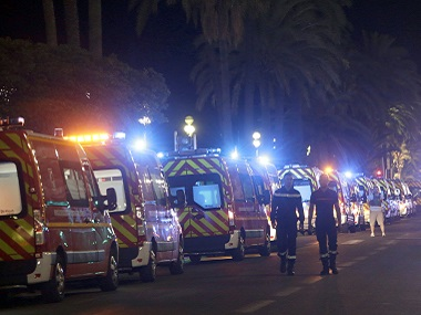 Ambulances line up near the scene of an attack after a truck drove on to the sidewalk and plowed through a crowd of revelers who'd gathered to watch the fireworks in the French resort city of Nice on Thursday night. AP