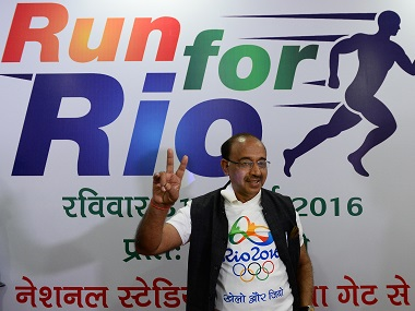 India's sports minister, and Rio Olympics delegate, Vijay Goel gestures after a press conference in New Delhi on July 25, 2016. India's wrestling body on July 25 threw its weight behind dope-tainted grappler Narsingh Yadav, saying he was innocent and should be given a chance to compete at the Rio Games. / AFP PHOTO / SAJJAD HUSSAIN