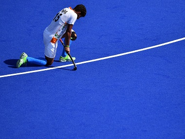 India's Uthappa Sannuvanda kneels on the pitch at the end of the men's quarterfinal hockey Belgium vs India match. AFP