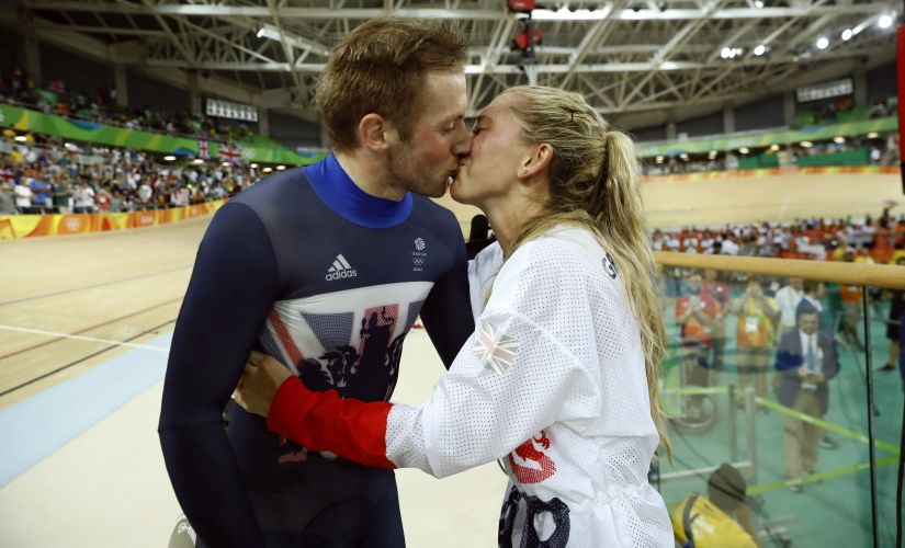 Laura Trott kisses her fiance Jason Kenny after he won the men's keirin cycling final. AP