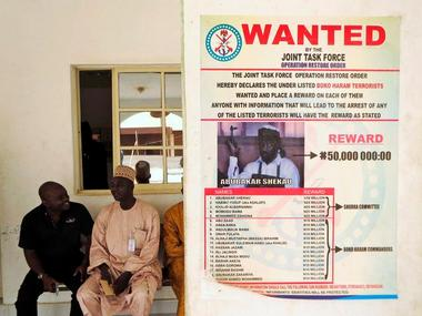 A poster advertising for the search of Boko Haram leader Abubakar Shekau is pasted on a wall. Reuters