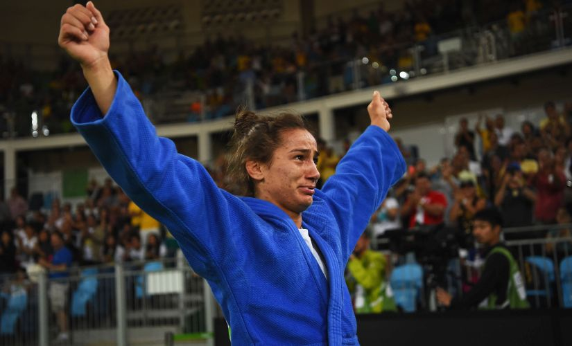 Majlinda Kelmendi of Kosovo shows her emotions as she celebrates winning the gold medal against Odette Giuffrida of Italy. Getty