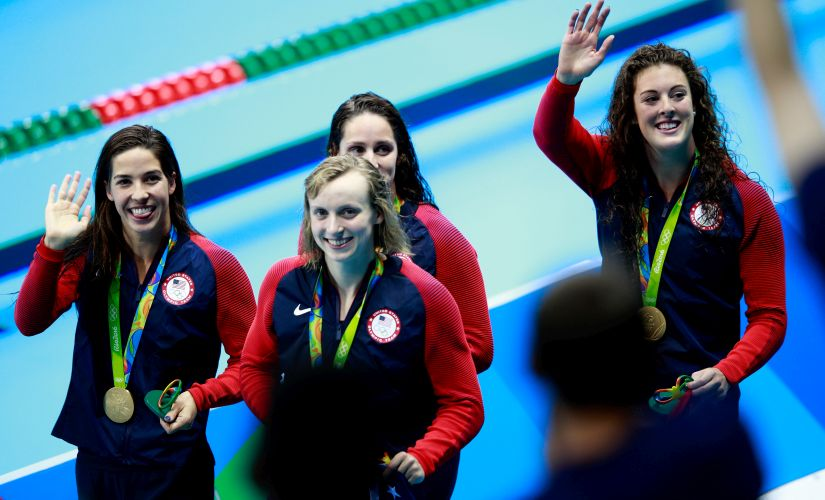 Gold medalists Allison Schmitt, Leah Smith, Maya Dirado and Katie Ledecky celebrate during the medal ceremony. Getty