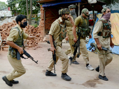 Jammu and Kashmir police personnel during the encounter with militants at Nowhatta. PTI