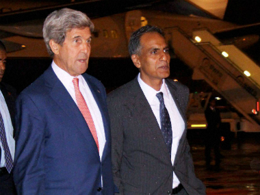 US Secretary of State John Kerry with US Ambassador to India, Richard Verma upon his arrival at New Delhi airport on Monday. PTI