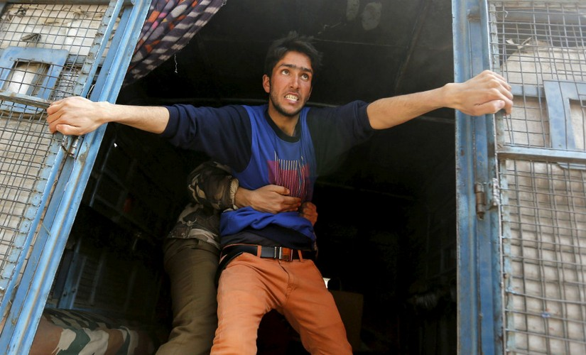 A Kashmiri youth resists arrest. Reuters