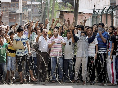 Srinagar: People shouting slogans during a march to Eidgha defying curfew, in response to the call of separatists, at Guru Bazar in Srinagar on Thursday. Authorities imposed strict curfew to thwart the separatists call. PTI Photo by S Irfan(PTI8_11_2016_000126B)