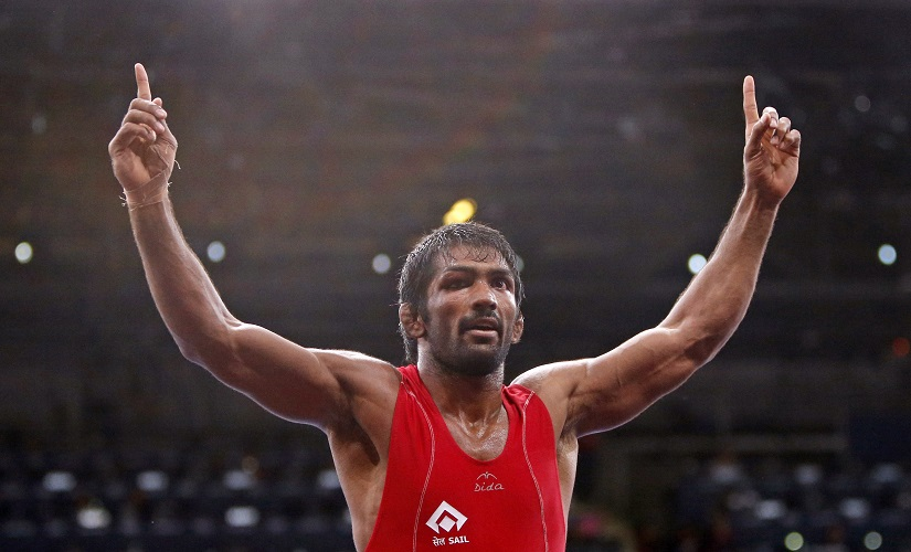 India's Yogeshwar Dutt celebrates his victory over North Korea's Jong Myong Ri for the gold medal on the Men's 60Kg Freestyle wrestling at the ExCel venue during the London 2012 Olympic Games August 11, 2012. REUTERS/Suhaib Salem (BRITAIN - Tags: OLYMPICS SPORT WRESTLING) - RTR36P5O