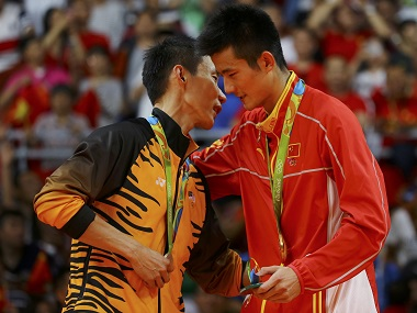 2016 Rio Olympics - Badminton - Men's Singles - Victory Ceremony - Riocentro - Pavilion 4 - Rio de Janeiro, Brazil - 20/08/2016. Gold medallist Chen Long (CHN) of China talks with silver medallist Chong Wei Lee (MAS) of Malaysia on the podium. REUTERS/Marcelo del Pozo FOR EDITORIAL USE ONLY. NOT FOR SALE FOR MARKETING OR ADVERTISING CAMPAIGNS.
